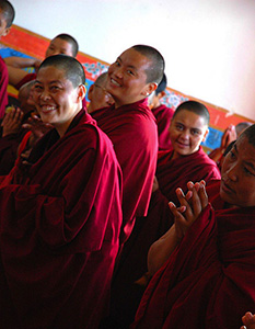 Tibetan nuns, smiling.