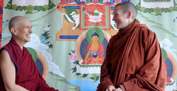 Venerable Chodron and Ayyta Tathaaloka sitting together and smiling.