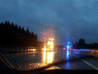Lights from cars in accident at night.