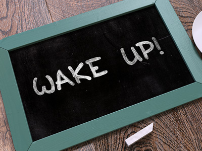 "Chalkboard with the words ""Wake up!"" written on it."
