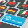 Flags from various countries on computer keyboard keys.