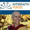 Venerable smiling with Interfaith Voices logo in background.