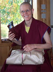Ven. Tarpa holding a gift and smiling.
