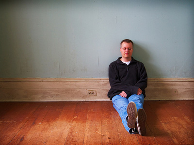 Man sitting on the floor in contemplation.