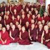 A large group of monastics posing for a photo.
