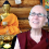 Venerable sitting in front of the Buddha, smiling while teaching on Zoom.