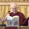 Venerable Chodron smiling with arms open while teaching.