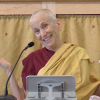 Venerable smiling and gesturing while teaching.